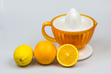 thirst quenching: Citrus juicer oranges and lemon isolated on a white background