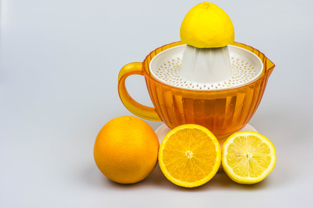 thirst quenching: Citrus juicer, oranges and lemon isolated on a white background Stock Photo