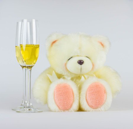 Happy valentines day greeting card with teddy and flutes of champagne Stock Photo