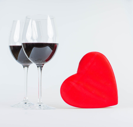 Happy valentines day greeting card with red heart and glasses of red wine
