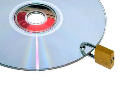 Disc under lock and key isolated on a white background. Stock Photo - 4744916