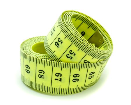 A coiled yellow measuring tape on white background photo