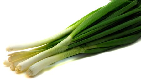 A bunch of fresh green onions (sometimes called shallots or scallions), isolated on white. Stock Photo - 4879495