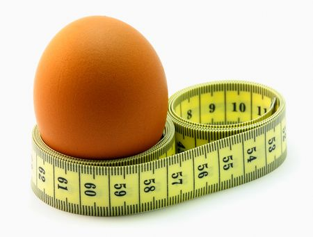 continence: A EGG WITH A MEASURING TAPE AROUND IT.
