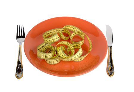 rigorous: Piastra con Measuring Tape. Focus On Measuring Tape. Isolati. Simboleggiano una dieta e il controllo sulle Meal