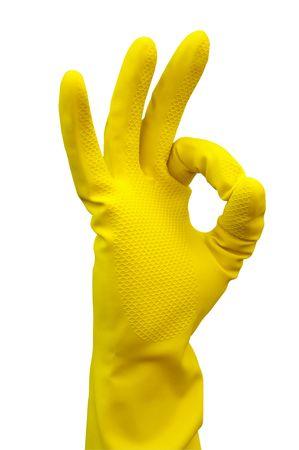 higienizar: Luva do l�tex para limpeza Fazendo um sinal da m�o OK Banco de Imagens