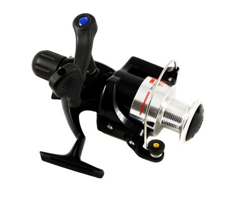 spinning reel: Black spinning reel isolated on white.