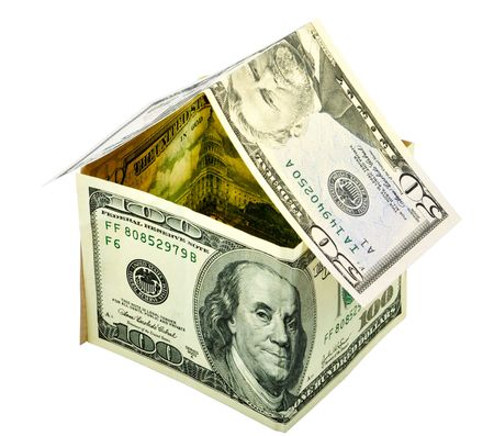 A house made from dollars. Useful concept for renting a house or paying the loan for a house. Isolated on white. photo