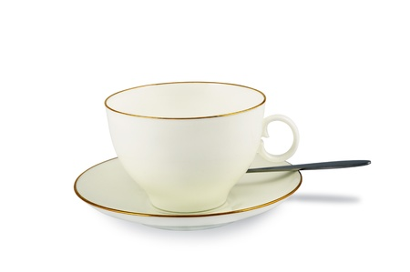 Empty classic white cup and saucer with teaspoon isolated on white with light shadow photo