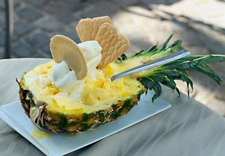 Ice cream with exotic fruits laid out in a pineapple photo
