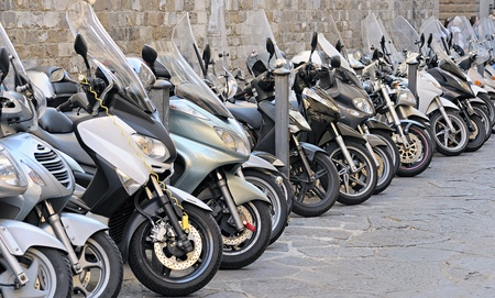mopeds: Rows of mopeds in Florence, Italy  Editorial