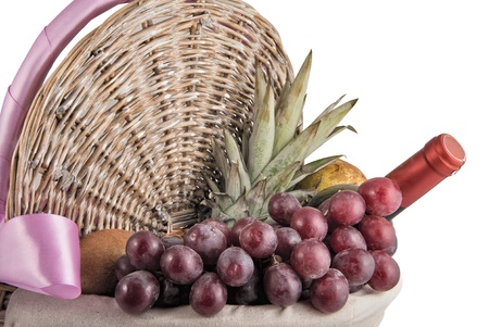 Picnic basket full of fruits and wine isolated on white Stock Photo - 12283243