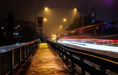 car lights: Car lights in the night foggy city Stock Photo