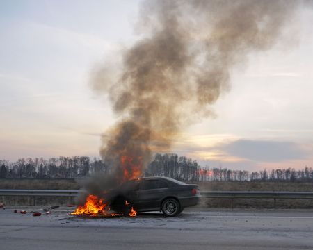 Landscape with Burning Car on the Road Stock Photo - 5858636