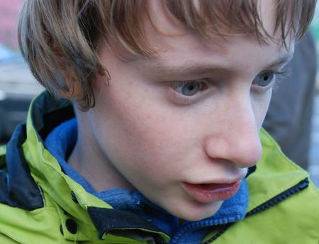 abstracted: Closeup of a boy with dull eyes abstracted into some problem