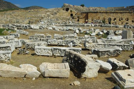 vividly: Panorama of Hieropolis with ruins of the city in the background and vividly littered remains of antiquities in the foreground