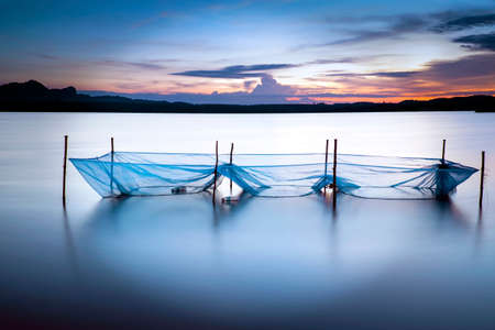 placid water: Long exposure of the net in the lake Stock Photo