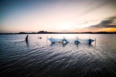 trawl: two man trawl in the shallow lake