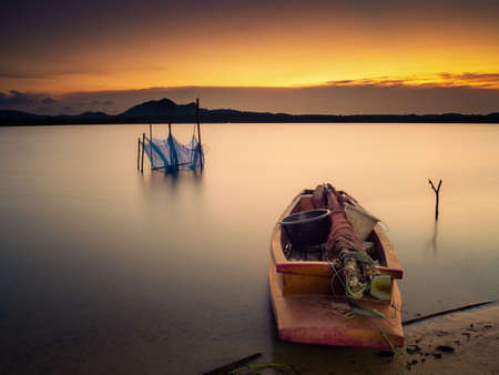 A fully loaded boat ready for fisherman to go out tonight Stock Photo