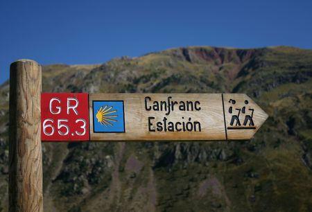 st jacques: Waymarking on the Camino de Santiago in Spain, long distance pilgrimage, Europe, mountains intentionally out of focus