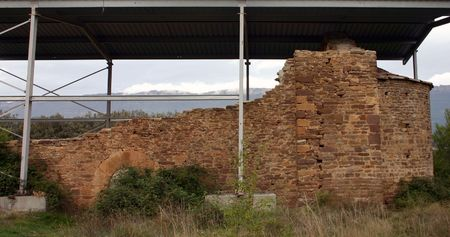 sheltered: ruined chapel in Spain, sheltered by a metal roof, waiting for repair Stock Photo