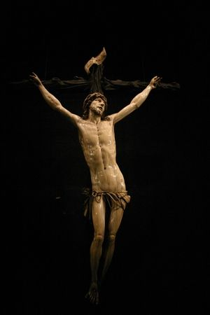 inri: crucifix against black background
