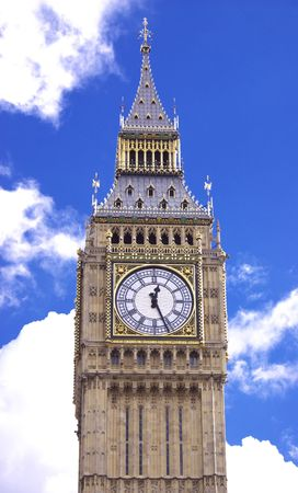 Big Ben with fluffy white clouds and blue sky photo