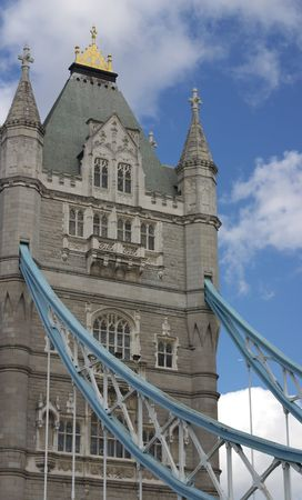 detail of Tower Bridge with fluffy white clouds and blue sky photo