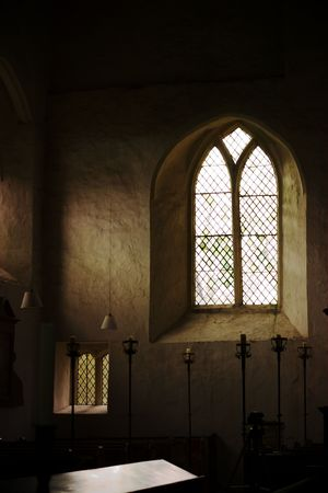 parish: Window in Chetwode Parish Church (former Abbey) in Buckinghamshire, England with empty table in front