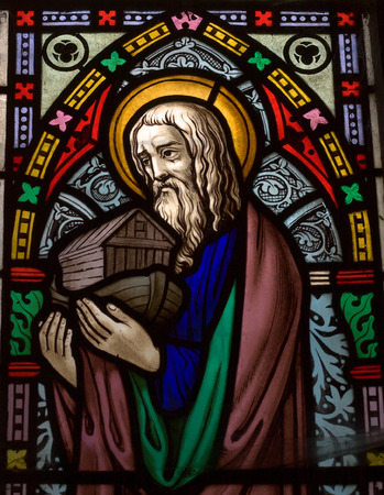 deluge: detail of victorian stained glass church window in Fringford depicting Noah with the ark in his arms Editorial