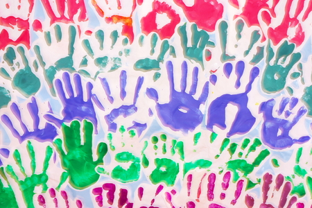 Many hand prints of children in different colors on white background Stock Photo - 1622390