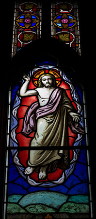 church window: detail of victorian stained glass church window in Fringford depicting Jesus ascending to heaven