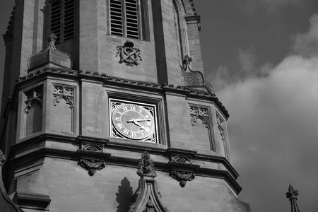 christ church: Black and white image of the main tower of Christ Church, Oxford, UK, named after the bell Old Tom it hauses. Christ Church is one of the colleges of Oxford Univeristy and at the same time the Cathedral church of the diocese of Oxford.