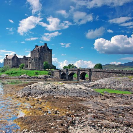 lochs: Eilean Donan Castle in Scotland, lays at the meeting point of three sea lochs (Duich, Alsh and Long) and is one of Great Britains most emblematic visitor attractions. Stock Photo