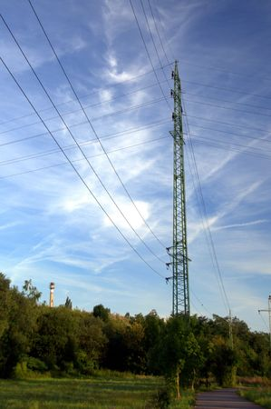 Power lines in countryside with cloudy sky photo