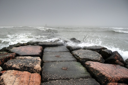 Stone pier in a storm photo