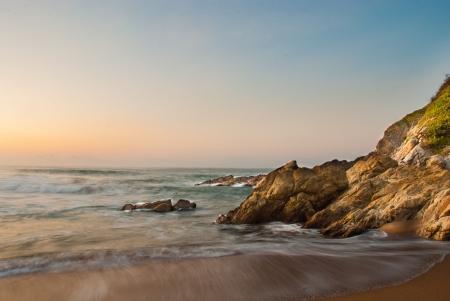 Waves on a beach with rocks photo