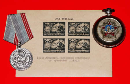 end of world: Photo of the Labor Veteran Medal and miniature sheet (issued in 1944) devoted to the end of the siege of Leningrad and speciial release of the pocket watch devoted to the victory in the seond world wart