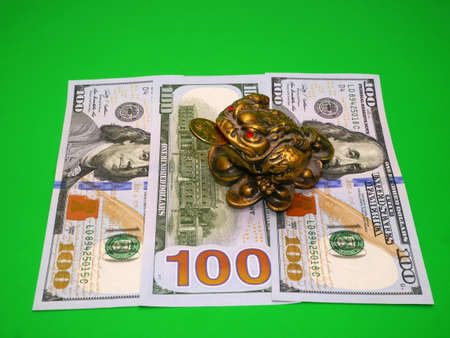 three-legged frog bringing luck and banknotes photo