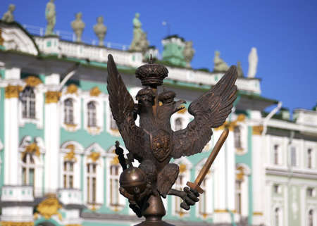 double headed eagle: Imperial eagle at the background of the Hermitage (Winter Palace)