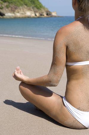 woman in bikini meditating yoga on costa rican tropical beach Stock Photo - 6196452
