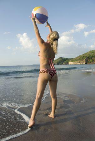woman in bikini playing with beachball on tropical beach, costa rica Stock Photo - 6472665