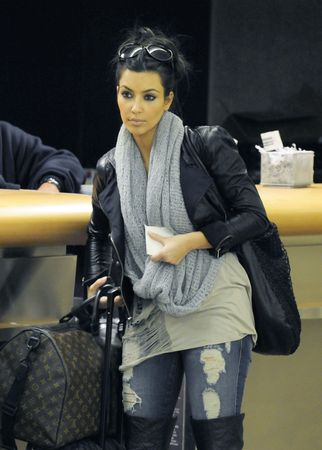 LOS ANGELES - FEBRUARY 21 : Model and socialite kim Kardashian is seen with her luggage at LAX. February 21, 2010 in Los Angeles, California Editorial