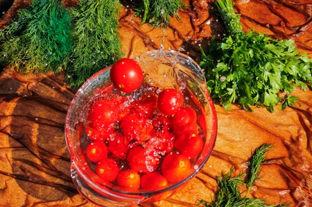 drop water: fresh tomatoes falling in pure water Stock Photo