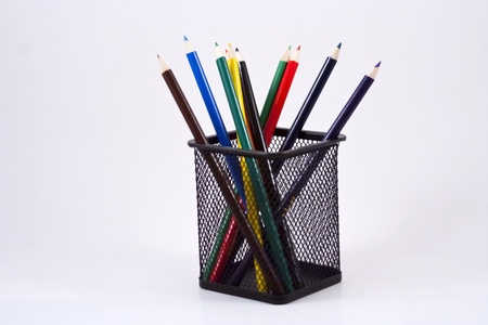 Color pencils in a black pencil holder on a white background. Stock Photo - 10506786