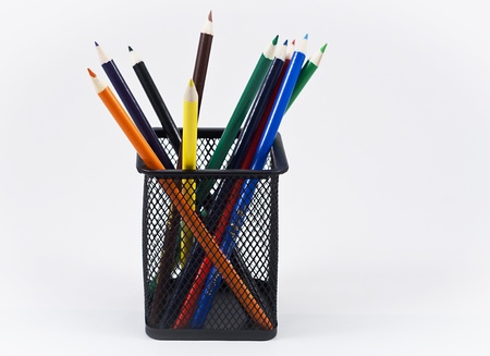 Color pencils in a black pencil holder on a white background. Stock Photo - 10506781