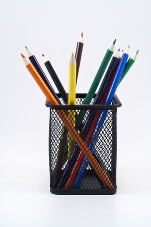 Color pencils in a black pencil holder on a white background. photo