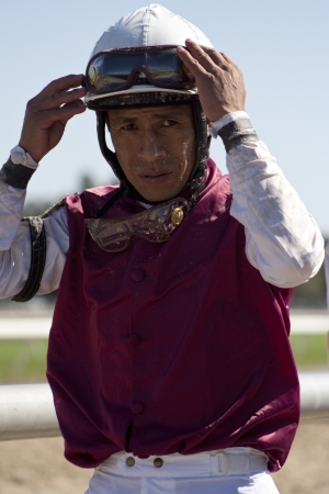 TAMPA BAY DOWNS, FL - FEB 13: Hall of Fame jockey Edgar Prado heads to the jockey room after a race, Tampa Bay, FL, on February 13, 2010,.