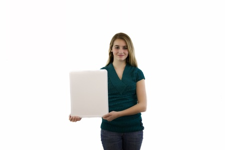 Young female with blank white board isolated. Stock Photo