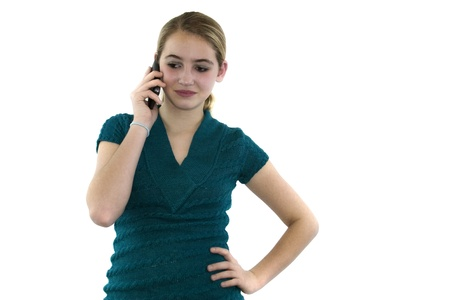 Young female uses cell phone on white background isolated.